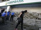 Activists brick up entrance to Sberbank of Russia branch in downtown Kyiv. PHOTOS+VIDEO