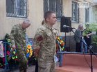 Kryvyi Rih residents kneel to bid last farewell to killed fighter Yurii Malkov. PHOTOS